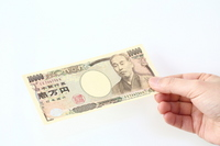 Image to pay ten thousand yen bill Stock photo [3635382] Ten