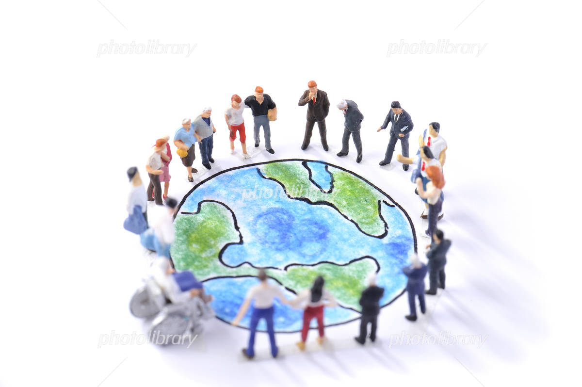 People who are standing around the Earth Photo