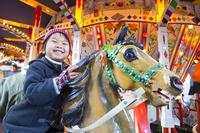 Children riding on merry-go-round Stock photo [4109937] children