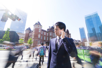 Businessman Conversation with a smartphone in front of the station in the morning Slow shutter blur Stock photo [5087181] Morning