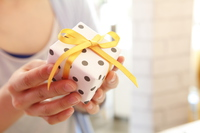 Women's hand with gifts Stock photo [5089291] Present