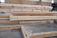 Newly built construction site of detached houses with stacked wood  Photo