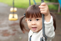 Infant playing with a swing (2 years old child)  Photo