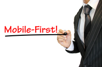 """Mobile First"" モバイルファーストを強調 written by a young businessman  モバイルファースト"
